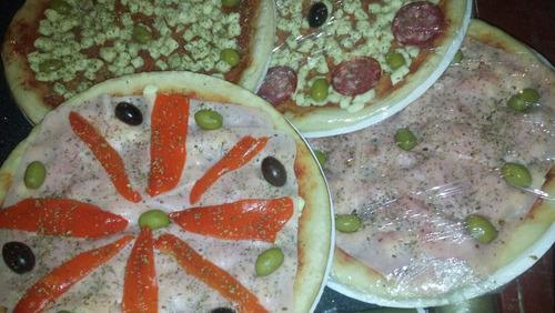 pizzas listas para hornear