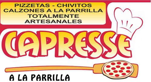 pizzas pizzetas calzone chivitos a la parrilla.