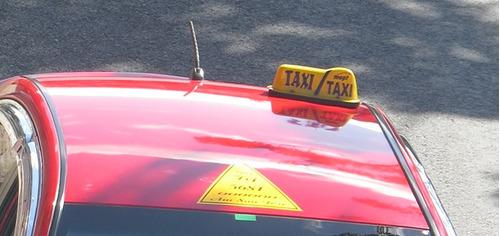 placa de taxi tsj 3887