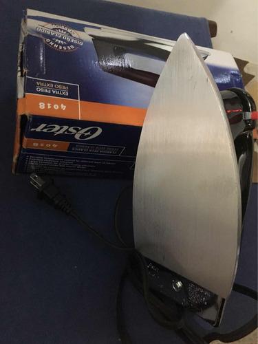 plancha de hierro oster model clásico 4018. como nueva
