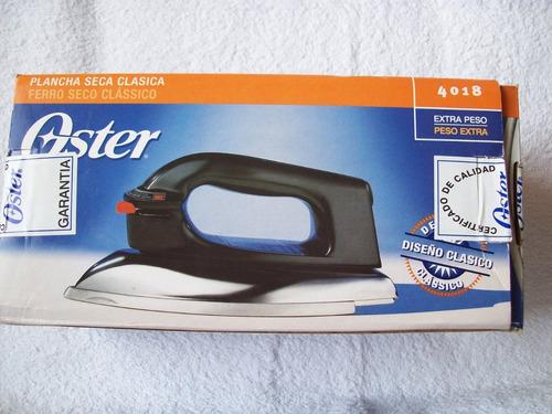plancha oster seca clásica modelo 4018. nueva, en su caja