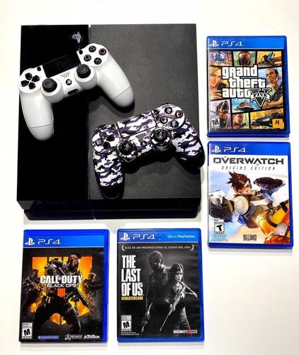 play station 4 fat 500gb + 2 joystick + 4 juegos fisicos