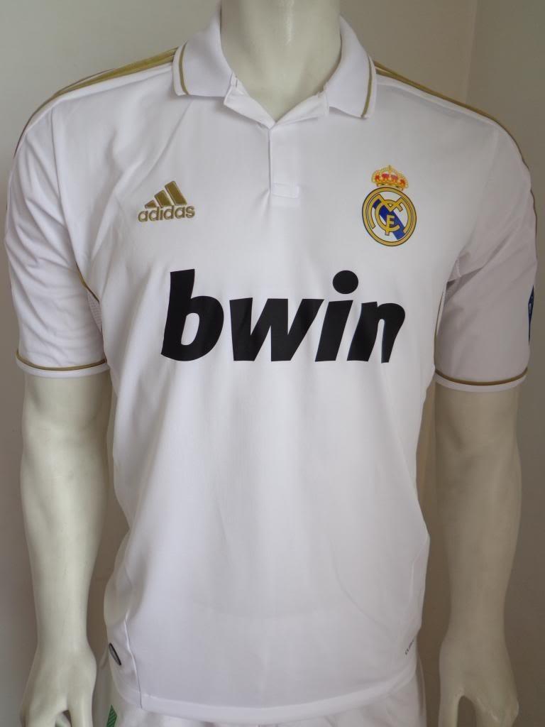 5084f789609d3 Playera Real Madrid Manga Corta Champions Con Porta Traje ...