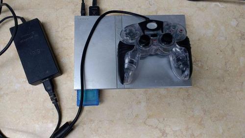 playstation 2 con un control y 4 juegos