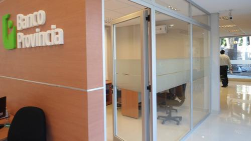 ploteo e instalación  vinilo esmerilado- vidrieras oficinas