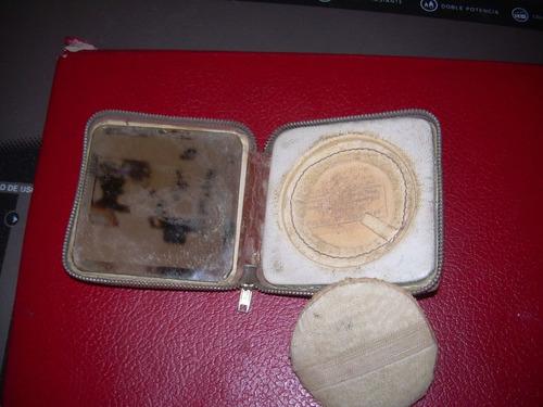 polvera de cuero antigua