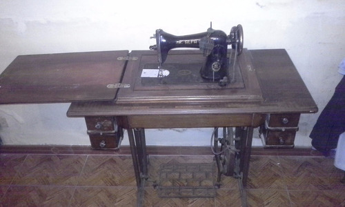popei.- maquina de coser alfa 1950