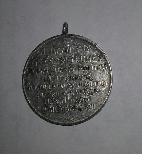 popei.- medalla del dean funes de 1911