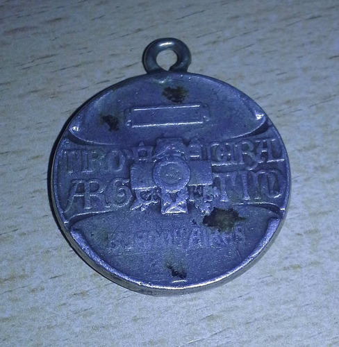 popei.- medalla del tiro federal argentino
