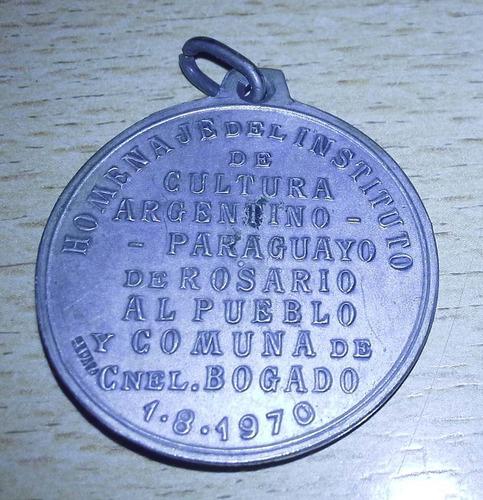 popei.- medalla homenaje al cnel bogado