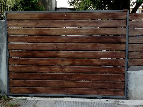 porton corredizo y cercos hierro y madera $1300