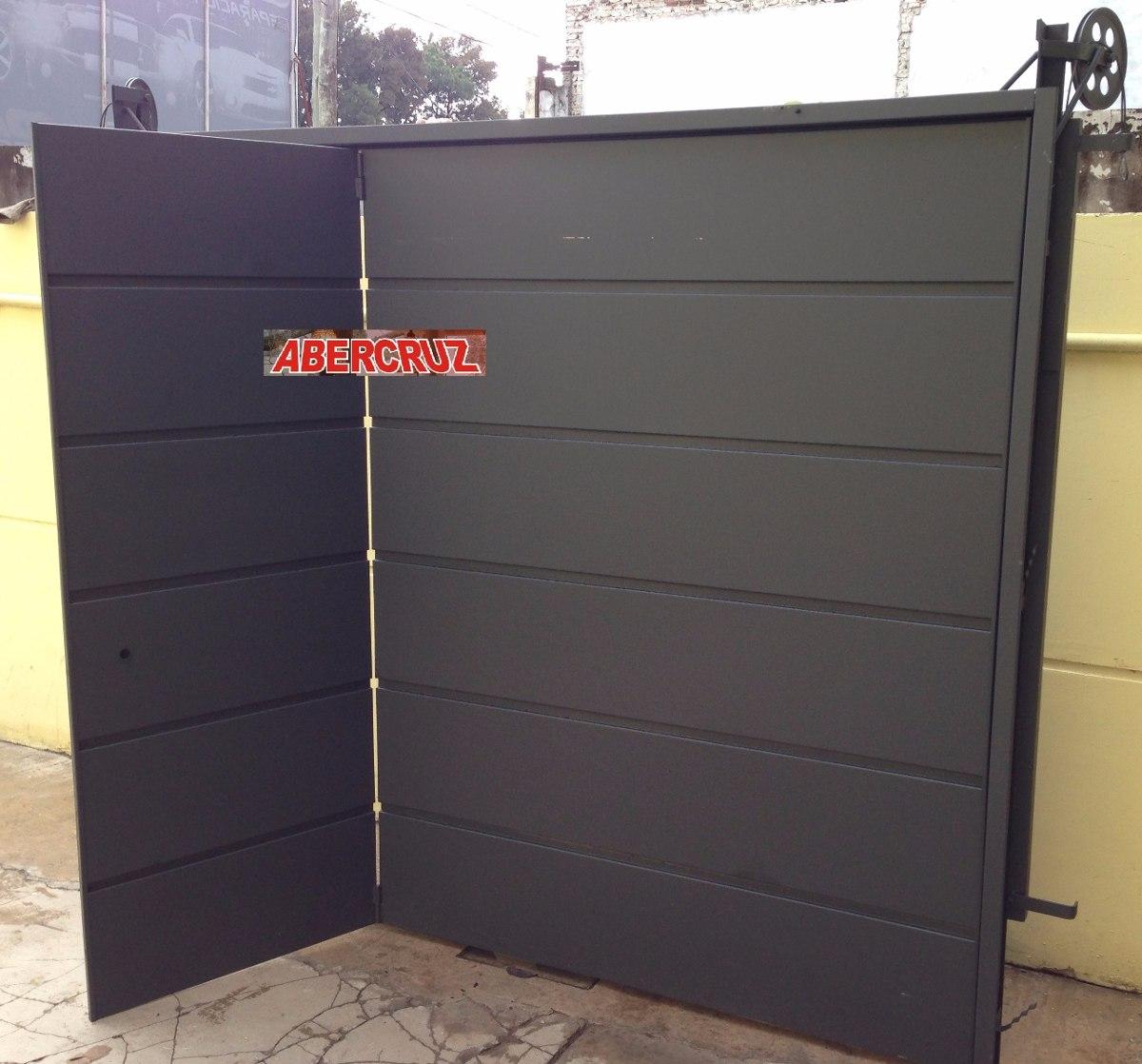 Porton de garaje awesome puerta garaje seccional ventana for Como hacer un porton de madera economico