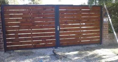 portones corredizos y cerramientos en hierro y madera