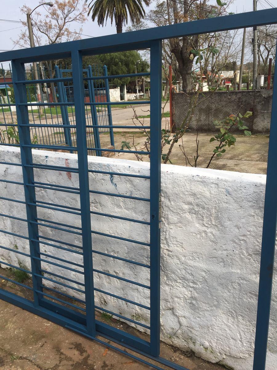 Portones de chapa para garaje puertas rejas frentes hierro for Cuanto sale una puerta