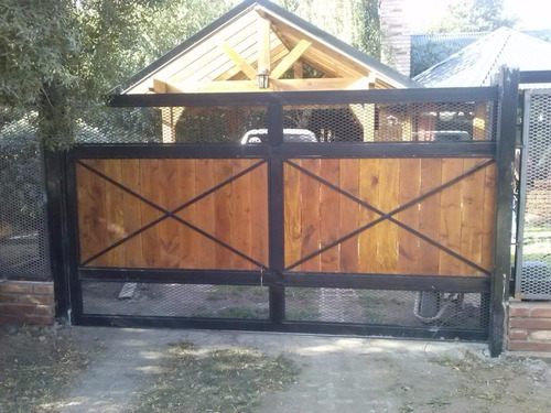 portones y cerramientos corredizos de hierro y madera