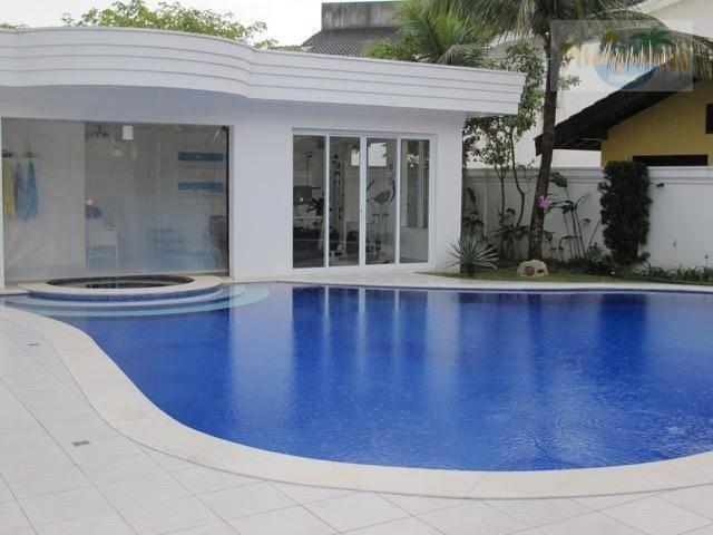 praia do pernambuco - casa no acapulco - alto padrão - em condomínio fechado - finamente decorada. - ca0054