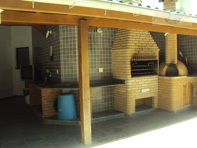praia do tombo excelente apartamento com 96 m² úteis, lazer total piscina, churrasqueira, salões etc... garagem, ampla varanda - ap2836