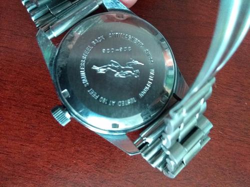 precioso reloj dolmy suizo cuerda caja y correa de acero