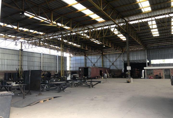 propiedad en gran galpon industrial en peaje a lampa
