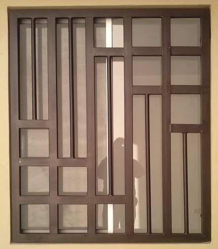 Protecciones de herreria con diferentes dise os 1 400 for Cuanto sale una puerta
