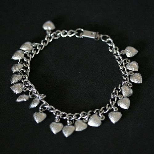 pu1720 - pulseira de aço com vários corações