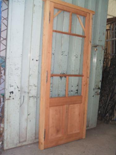 puerta de cedro estilo griega