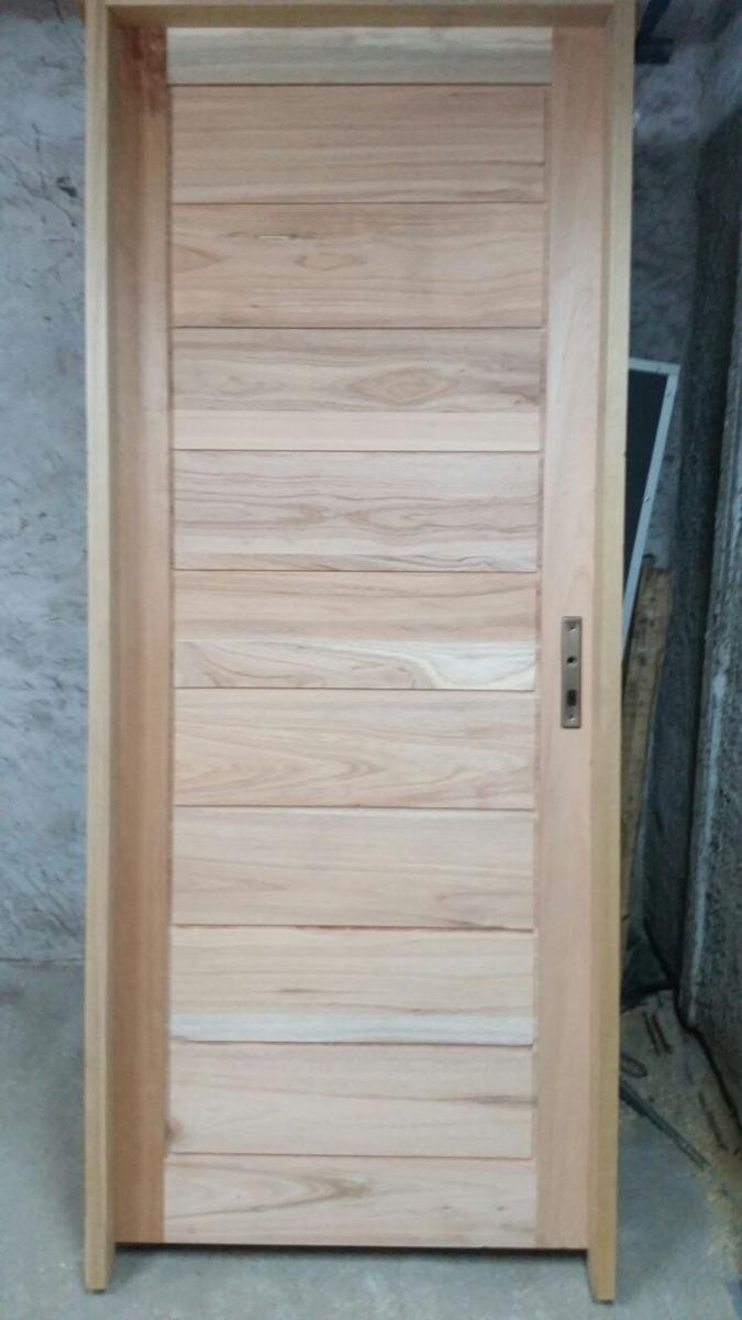 Puerta de madera maciza en eucaliptus muy prolijas en for Puertas madera maciza