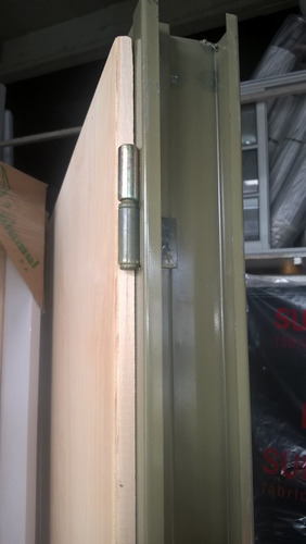 puerta placa pino 70 x 2,00 marco de chapa  pared de 7 cms