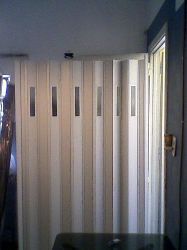 puerta plegadiza vidriada  envio gratis