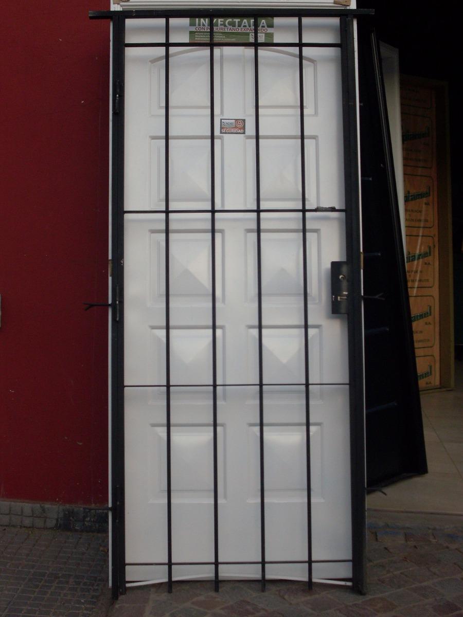 Rejas de hierro para puertas puerta de hierro lacada for Puertas hierro exterior