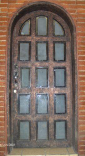 Puerta reticula residencial de herreria rustica fina m2 for Imagenes puertas de herreria para exterior