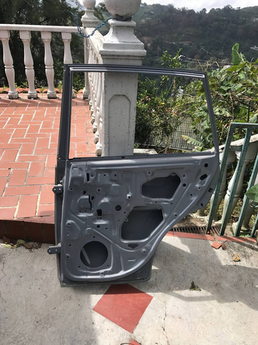 puerta trasera derecha chery tiggo original 07/14