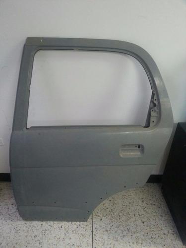 puerta trasera izquierda terios 2002-2007 original