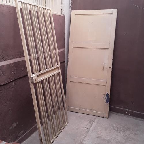 puerta y protector de hierro