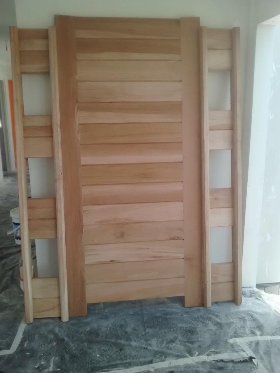 Puertas de acceso madera instaladas a pedido en for Puertas de acceso principal