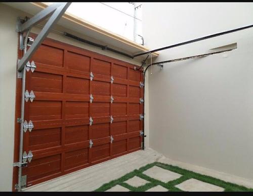 puertas de garaje levadizo y seccional en fierro y madera