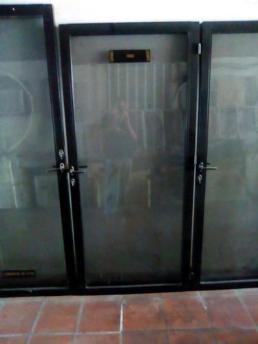 puertas de vidrio bronce con marco de aluminio