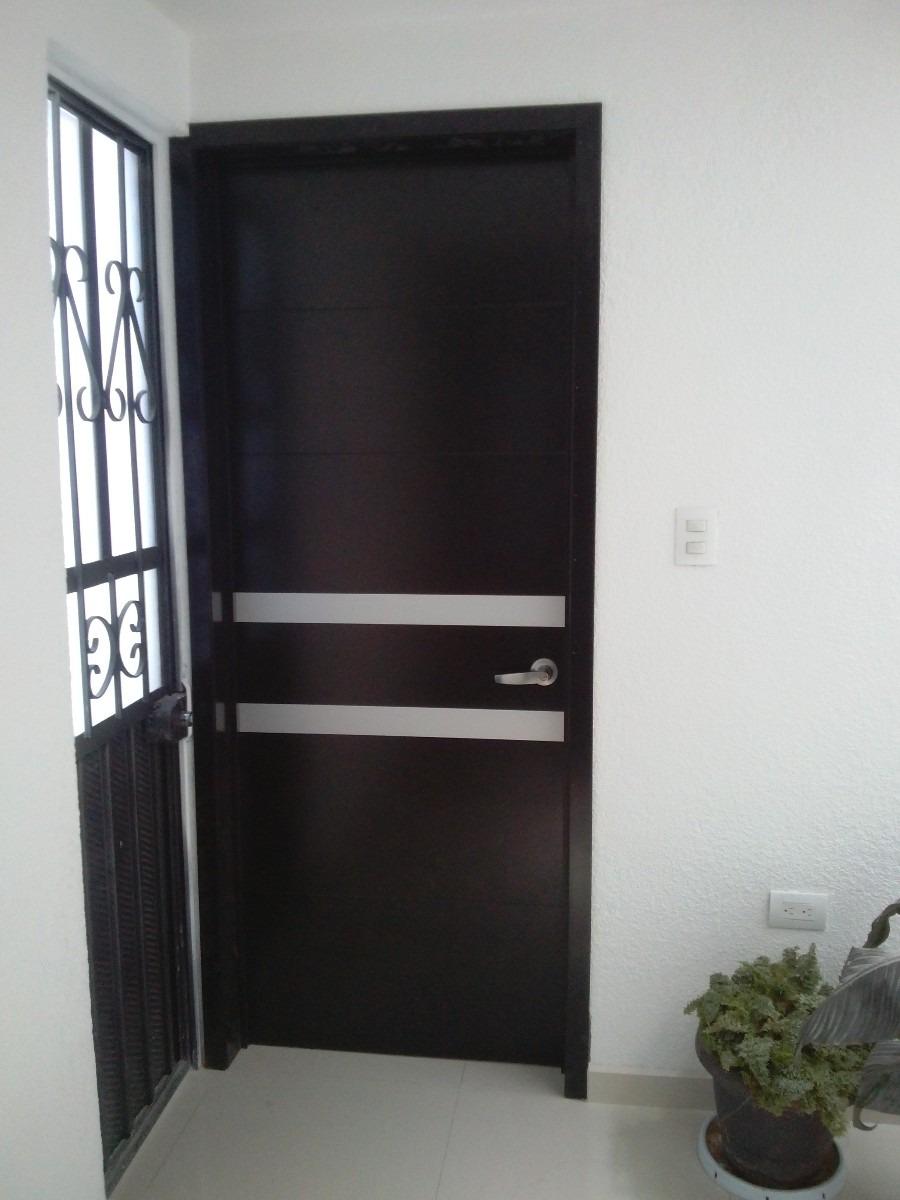 Puertas minimalistas echas a base de madera 100 natural for Puertas para casas minimalistas