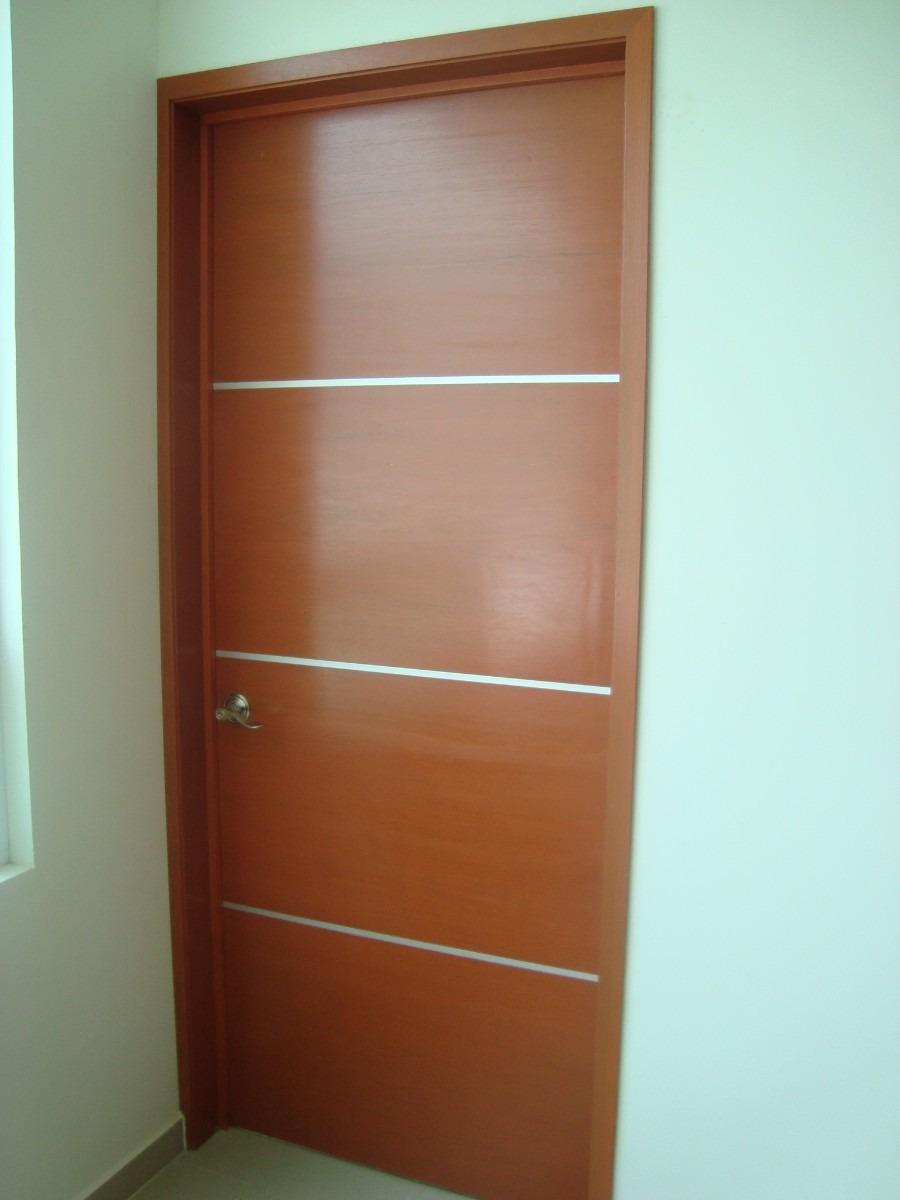 Puertas minimalistas echas a base de madera 100 natural for Puertas de madera interiores minimalistas