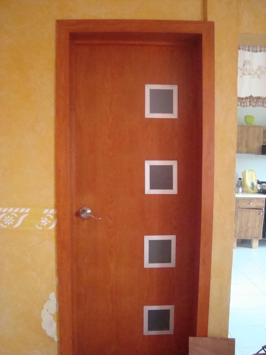 Puertas modernas echas a base de madera 100 natural for Puertas madera modernas exterior