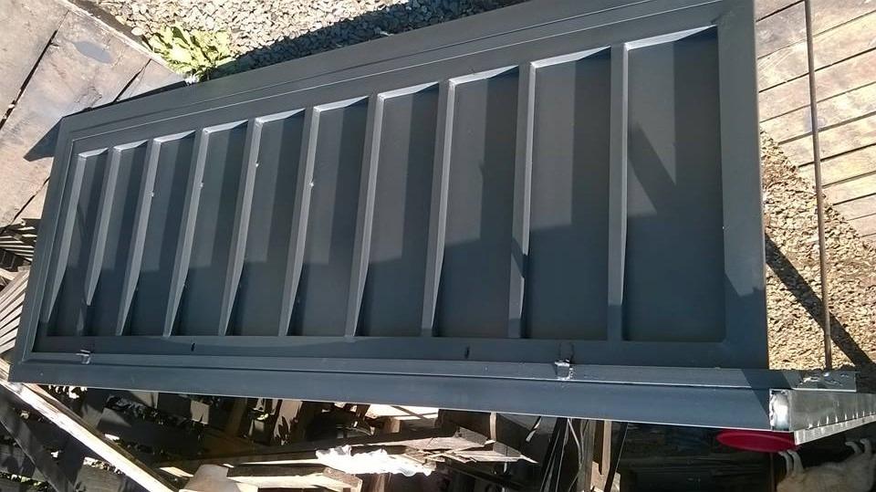 Puertas portones garage en madera y hierro for Puertas de madera para garage