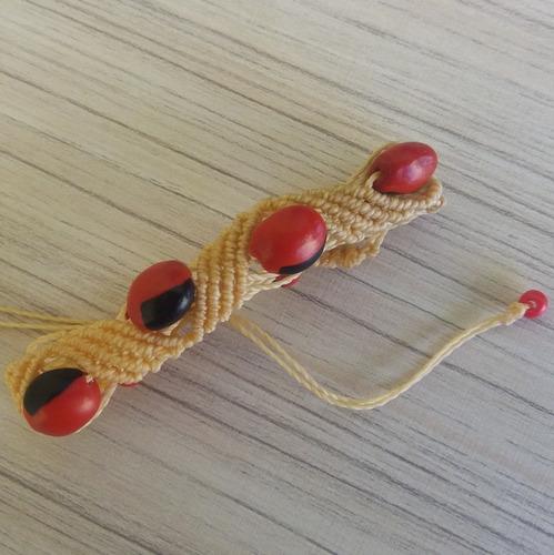 pulseira macramê com sementes olho de cabra ref: 7555