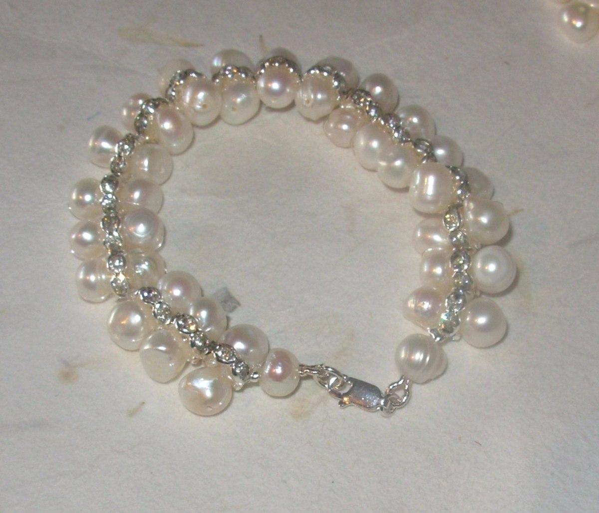 3d5cf6052b9a pulsera con perlas naturales cultivadas plata y acero. Cargando zoom.