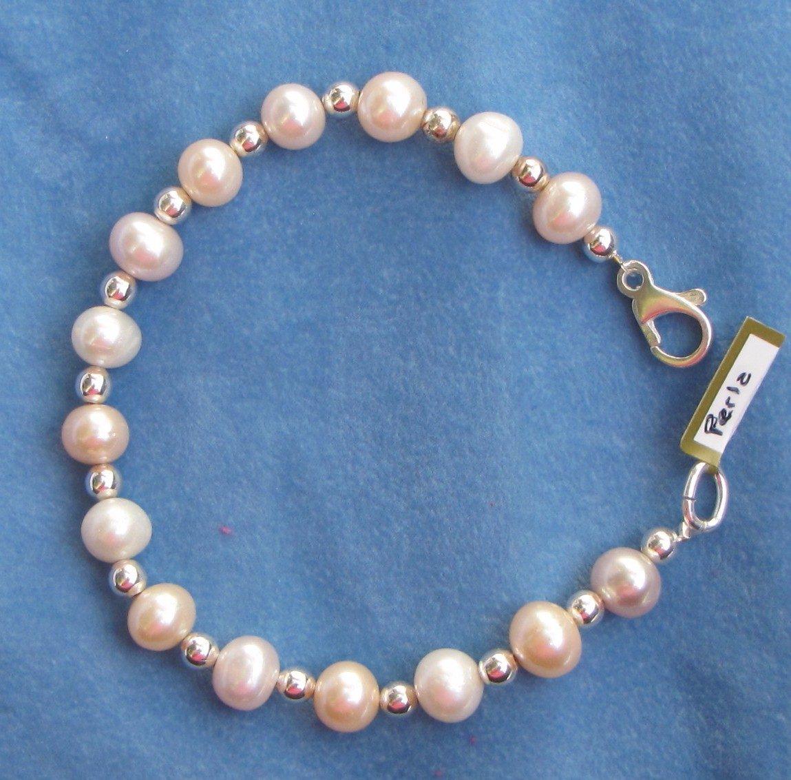 584f929191cd pulsera de plata con perlas naturales de rio. Cargando zoom.