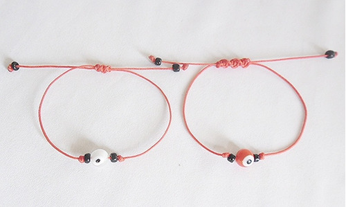 pulsera hilo chino  par (el y ella) con un  ojo proteccion