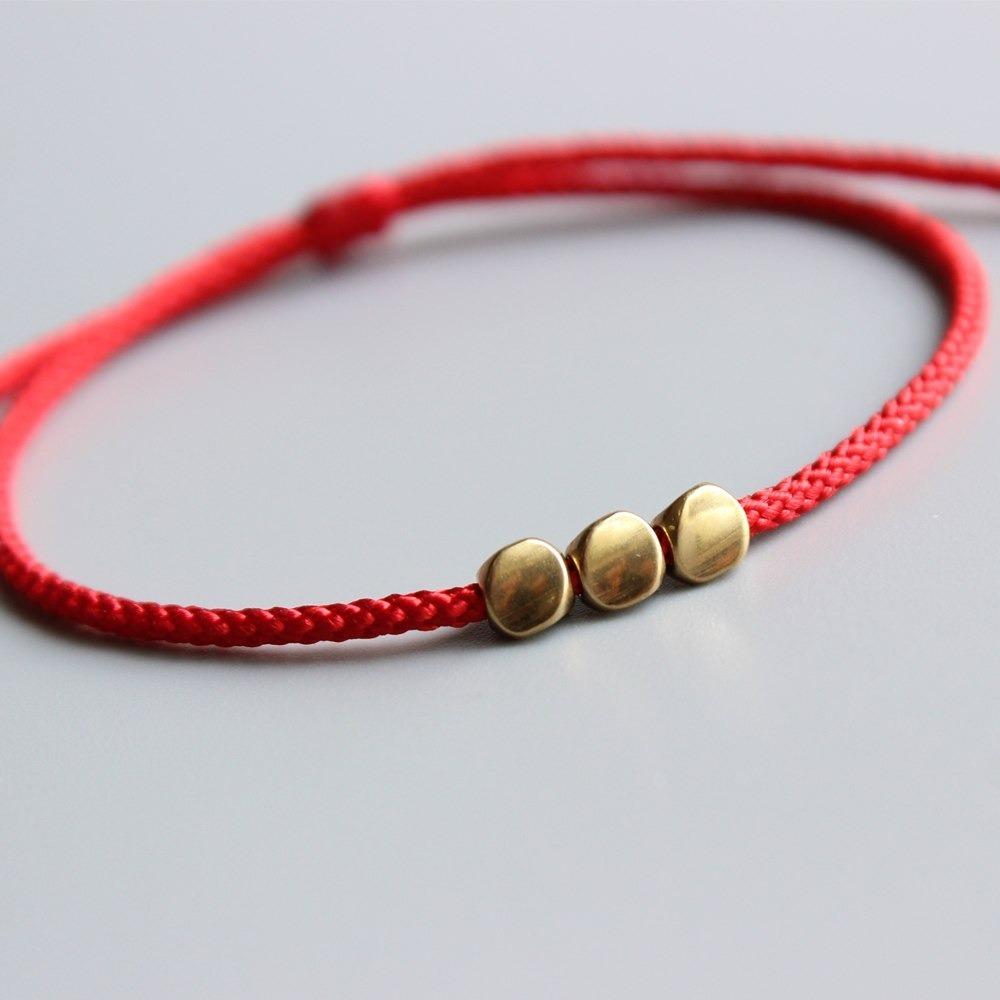 f8758abb26e6 Pulsera Hilo Rojo Tibetana Nudos De Protección. Nylon. -   179.00 en ...