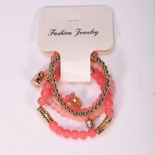 pulsera moda juvenil con perlas de color y un corazón dorado