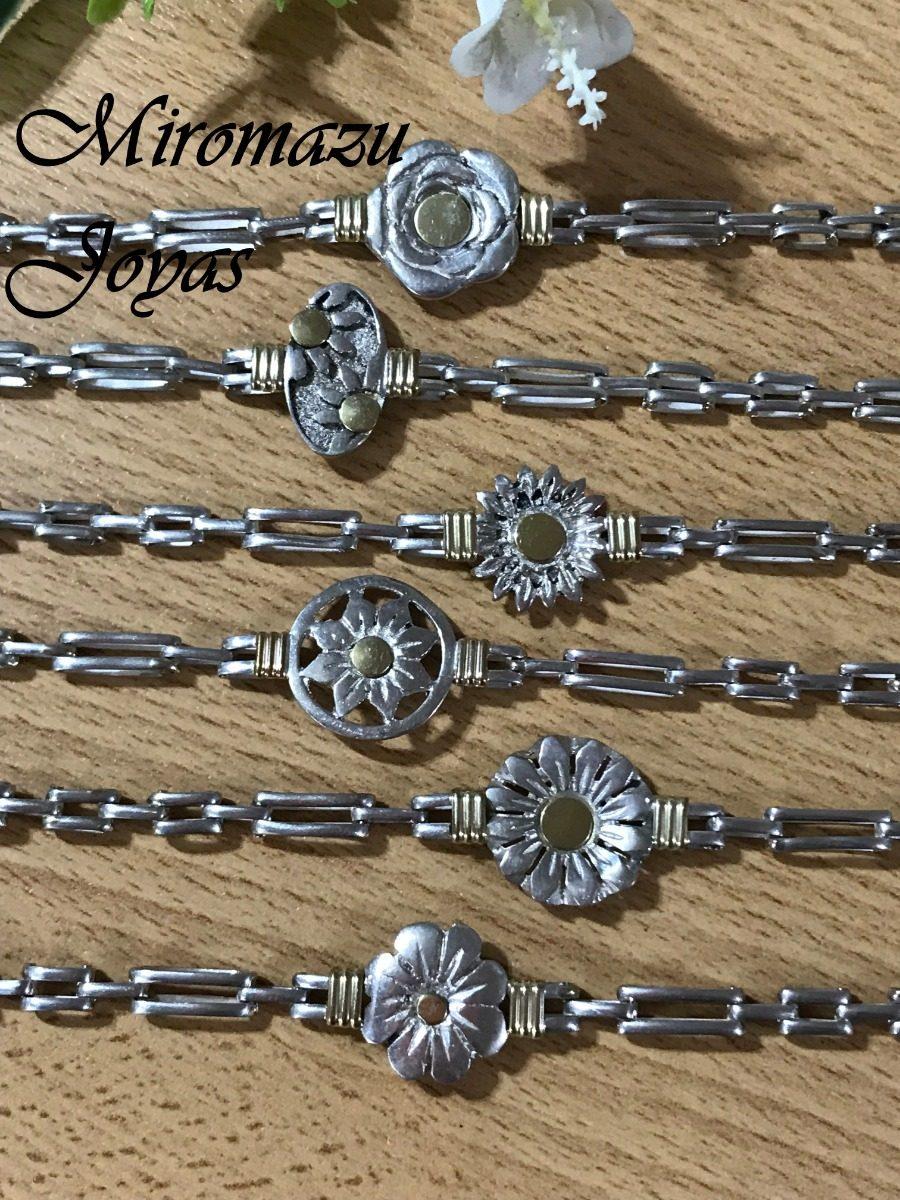 21bb381abcee pulsera plata y oro flores. Cargando zoom.