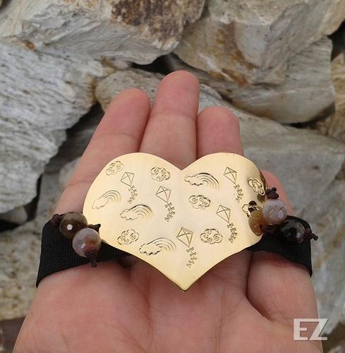 pulseras diseños de ardillas y papagayos . orfebrería