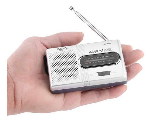 radio portátil am fm funciona con 2 pilas aa incluida cuerda